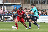 Ben Dempsey of Charlton gets ready to challenge  Welling's Luke Rooney during Welling United vs Charlton Athletic, Friendly Match Football at the Park View Road Ground on 13th July 2019