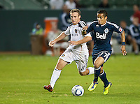 CARSON, CA - September 17, 2011: LA Galaxy midfielder Chris Birchall (8) and Vancouver Whitecaps midfielder Camilo (8) during the match between LA Galaxy and Vancouver Whitecaps at the Home Depot Center in Carson, California. Final score LA Galaxy 3, Vancouver Whitecaps 0.