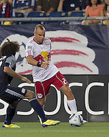 New York Red Bulls midfielder Joel Lindpere (20) dribbles. In a Major League Soccer (MLS) match, the New England Revolution tied New York Red Bulls, 2-2, at Gillette Stadium on August 20, 2011.