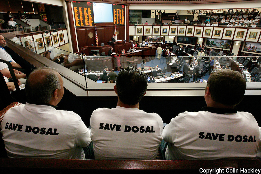TALLAHASSEE, FL. 4/24/09-NOTAX4-24 CH9-Some of the 200 Dosal Tobacco Corp. employees who closed their Opa Locka plant Friday and traveled to Tallahassee to show lawmakers their opposition to a proposed tax on their products watch the House of Representatives. A proposed 40 cent tax could put their company out of business...COLIN HACKLEY PHOTO FOR DOSAL