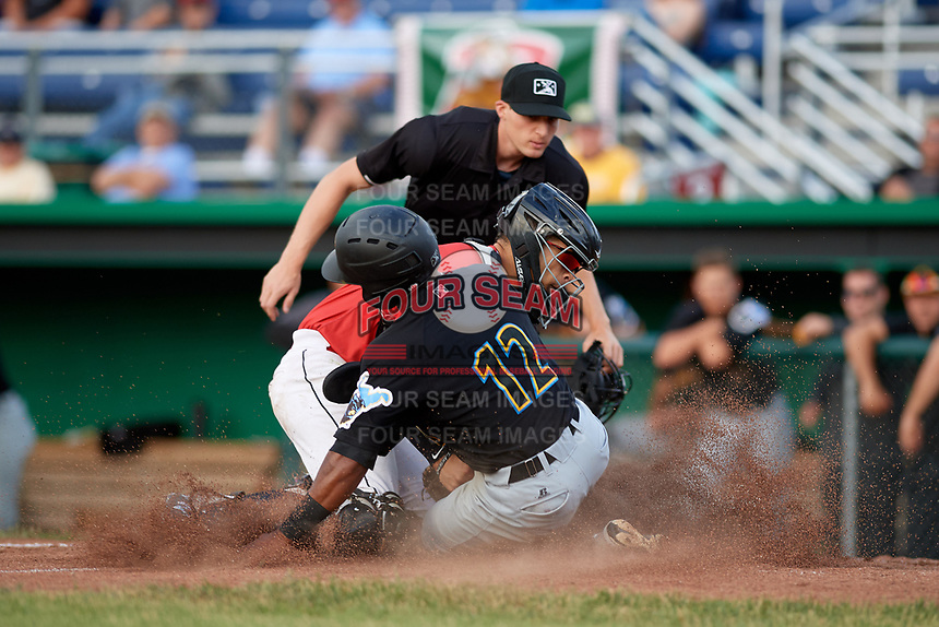 Batavia Muckdogs catcher Igor Baez (29) blocks the plate as Raul Siri (12) tries to slide into the plate in front of home plate umpire Tyler Witte during a game against the West Virginia Black Bears on June 19, 2018 at Dwyer Stadium in Batavia, New York.  West Virginia defeated Batavia 7-6.  (Mike Janes/Four Seam Images)