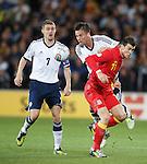 Darren Fletcher and Danny Fox with Gareth Bale
