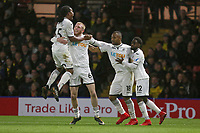 Jordan Ayew of Swansea City (3rd L) celebrates his goal with team mates Renato Sanches, Oliver McBurnie and Nathan Dyer during the Premier League match between Watford and Swansea City at the Vicarage Road, Watford, England, UK. Saturday 30 December 2017