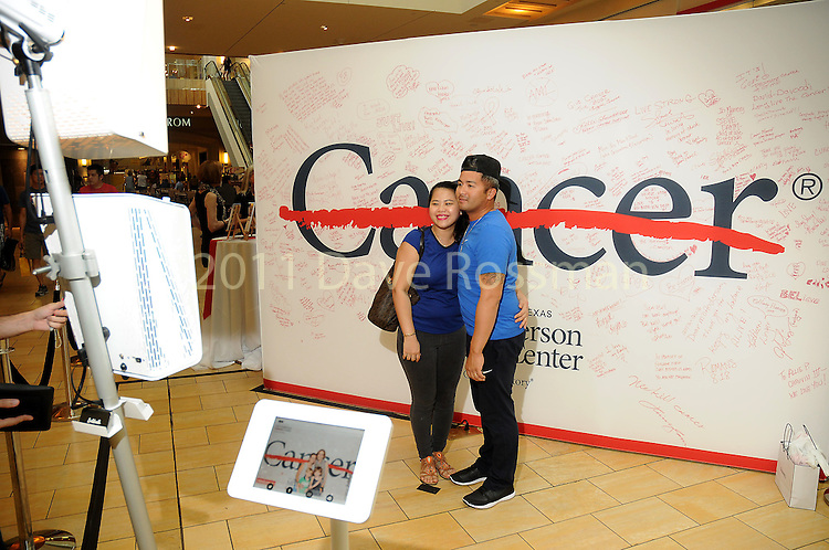 Guests take a photo at the M.D. Anderson Back to School Fashion show at the Galleria Saturday Aug. 06,2016.(Dave Rossman Photo)