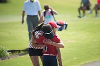 NWA Democrat-Gazette/CHARLIE KAIJO Michelle Canode of Rogers hugs Parker Canode, 8, during a junior golf tournament, Sunday, June 10, 2018 at The First Tee Learning Center in Lowell.<br /><br />A joint initiative founded in 2013 by the Masters Tournament, United States Golf Association and The PGA of America, the Drive, Chip and Putt Championship is a free nationwide junior golf development competition aimed at growing the game by focusing on the three fundamental skills employed in golf.<br /><br />By tapping the creative and competitive spirit of girls and boys ages 7-15, the Drive, Chip and Putt Championship provides aspiring junior golfers an opportunity to play with their peers in qualifiers around the country. Participants who advance through local, sub-regional and regional qualifying in each age/gender category earn a place in the National Finals, which is conducted at Augusta National Golf Club the Sunday before the Masters Tournament and is broadcast live by Golf Channel.<br /><br />Over 160 boys and girls throughout Northwest Arkansas have registered to compete in local qualifier.
