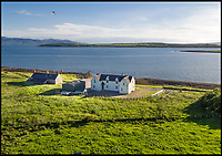BNPS.co.uk (01202 558833)<br /> Pic:  Strutt&Parker/BNPS<br /> <br /> The Port House.<br /> <br /> A stunning Scottish island has emerged for sale for just £1.4million - the cost of a London terraced home.<br /> <br /> Inchmarnock, at the northern end of the Sound of Bute in the Firth of Clyde, is 2.5 miles long, half a mile wide and has 4.75miles of coastline.<br /> <br /> The 660 acre island has a fascinating history, having been a target of Viking raids and used as a D-Day training ground - with bomb craters still visible in its landscape.<br /> <br /> A farmer even discovered the remains of a local Bronze Age woman, the Queen of the Inch, on the island in the 1960s. She lay in a stone cist wearing a black lignite necklace and carrying a flint dagger.