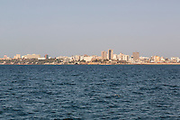 Dakar Skyline from Goree Island, Senegal.  The largest building on the left is a government office building.  The white building to the right of that is the presidential palace.