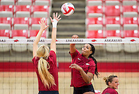 NWA Democrat-Gazette/JASON IVESTER <br /> Senior Chanell Clark-Bibbs sends the ball over the net on Monday, Aug. 24, 2015, during practice inside Barnhill Arena in Fayetteville.