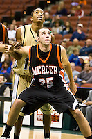 January 9, 2009:    Mercer forward Brian Mills (25) fights for rebound position in  Atlantic Sun Conference action between the Jacksonville Dolphins and the Mercer Bears at Veterans Memorial Arena in Jacksonville, Florida.  Jacksonville defeated Mercer 80-59.