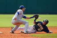 Seton Hall Pirates shortstop Guiseppe Papaccio #2 can not handle the throw as Patrick Biondi #26 slides in safely during a game against the Michigan Wolverines at the Big Ten/Big East Challenge at Al Lang Stadium on February 18, 2012 in St. Petersburg, Florida.  (Mike Janes/Four Seam Images)