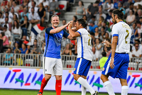 June 17th 2017; Allianz Riviera, Nice, France; Legends football international, France versus Italy;  Emmanuel Petit (France) high fives the own goal from Massimo Oddo (Ita)
