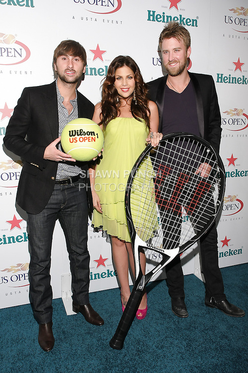 Dave Haywood, Hillary Scott, and Charles Kelly of Lady Antebellum play with oversized Tennis Racket at the US Open Player Party at The Empire Hotel, August 27, 2010.