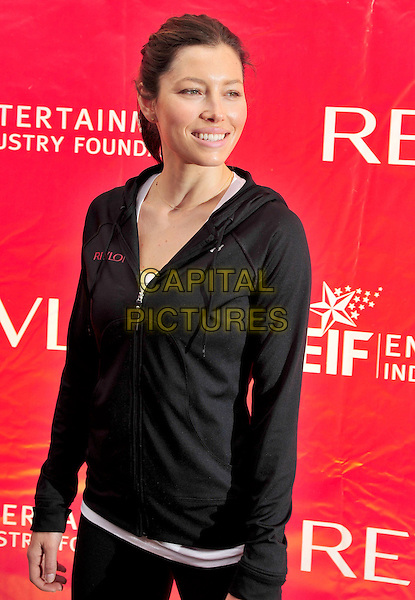 JESSICA BIEL .13th Annual EIF Revlon Run Walk For Women held in Times Square, New York, NY, USA, 1st May 2010..half length black hoodie white t-shirt top sports hair up smiling.CAP/ADM/BM.©Bill Menzel/AdMedia/Capital Pictures.