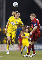 24 APRIL 2010:  Steven Lenhart of the Columbus Crew (32) heads the ball Real Salt Lakes' Nat Borchers (6) defends during the Real Salt Lake at Columbus Crew MLS soccer game in Columbus, Ohio. Columbus Crew defeated RSL 1-0 on April 24, 2010.