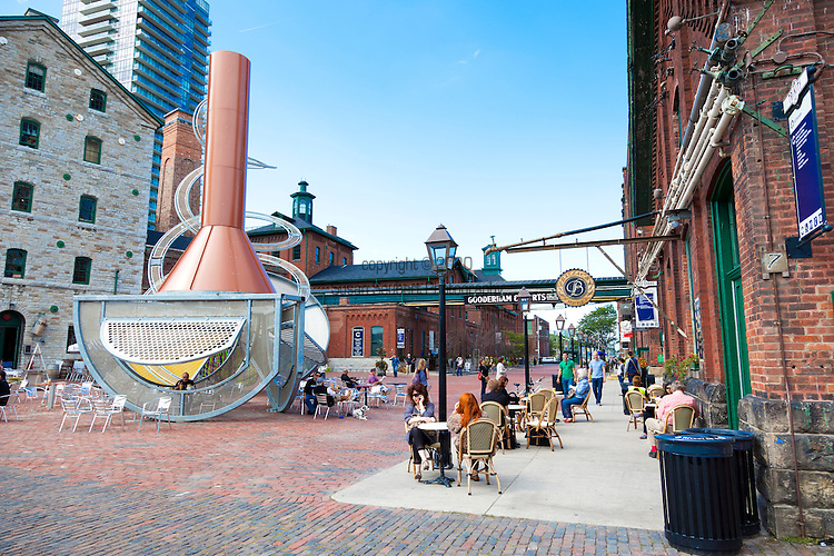 The Distillery District is a historic and entertainment precinct located east of Downtown Toronto, Ontario, Canada. It contains numerous cafes, restaurants and shops housed within heritage buildings of the former Gooderham and Worts Distillery. The 13-acre district comprises more than 40 heritage buildings and 10 streets, and is the largest collection of Victorian era industrial architecture in North America.