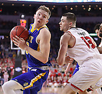 SIOUX FALLS, SD: MARCH 6: Reed Tellinghuisen #23 of South Dakota State spins on Matt Mooney #13 of South Dakota during the Summit League Basketball Championship on March 6, 2017 at the Denny Sanford Premier Center in Sioux Falls, SD. (Photo by Dick Carlson/Inertia)