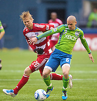Dallas FC forward Brek Shea battles with Seattle Sounders FC midfielder Osvaldo Alonso  during play at Qwest Field in Seattle Saturday May 14, 2011. Dallas won the game 1-0.