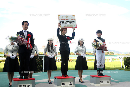(L-R)  Ippo Sameshima,  Yoshiko Kuriyama, Kyosuke Maruta,<br /> SEPTEMBER 14, 2014 - Horse Racing :<br /> Owner Yoshiko Kuriyama, trainer Ippo Sameshima and jockey Kyosuke Maruta celebrate during the award ceremony after Little Gerda won the Summer Sprint Series at Hanshin Racecourse in Hyogo, Japan. (Photo by Eiichi Yamane/AFLO)