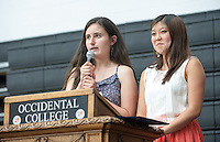From left, Larissa Saco '14 and Megan Sumida '14 during Senior Brunch and Class Day, May 16, 2014 in Rush Gym. (Photo by Marc Campos, Occidental College Photographer)