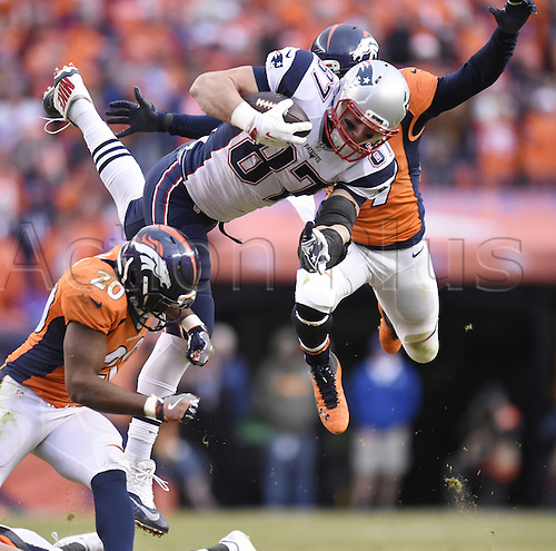 24.01.2016. Denver, Colorado, USA. The NFL AFC Championship American Football match. Broncos defenders Josh Bush, left, and Danny Trevathan defend Patriots tight end Rob Gronkowski during the fourth quarter of the AFC Championship game on Sunday