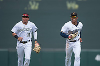 Salt River Rafters center fielder Corey Ray (2) of the Milwaukee Brewers organization, and Yonathan Daza (11), of the Colorado Rockies organization, jogs toward the dugout between innings of an Arizona Fall League game against the Mesa Solar Sox on October 30, 2017 at Salt River Fields at Talking Stick in Scottsdale, Arizona. The Solar Sox defeated the Rafters 8-4. (Zachary Lucy/Four Seam Images)