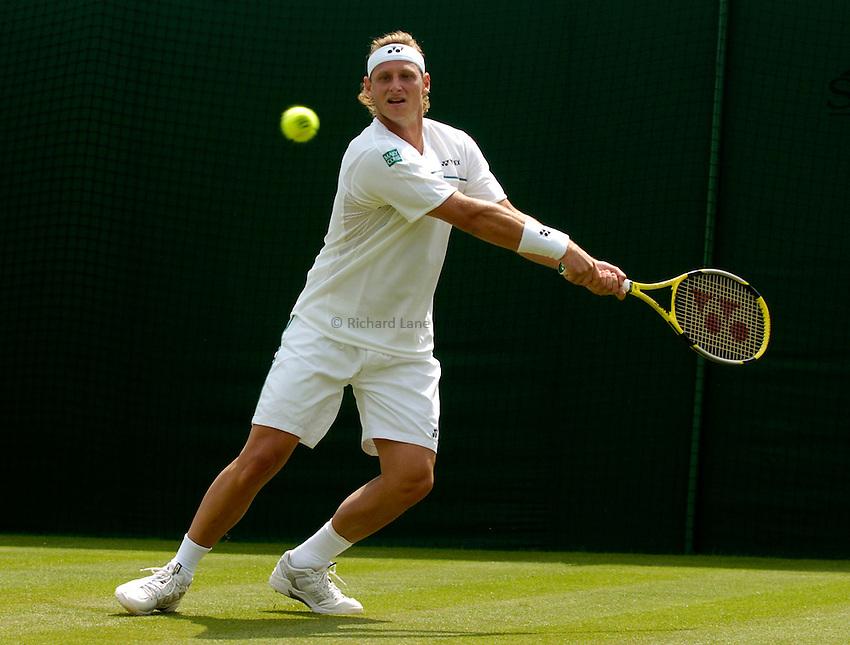 Photo: Richard Lane..Wimbledon Championships. 27/06/2006. .David Nalbandian of Argentina returns.