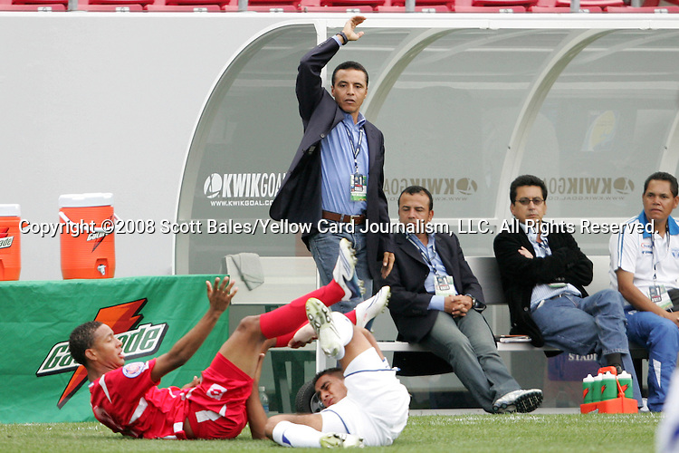 11 March 2008: Honduras head coach Alexis Mendoza (standing) looks for a call as players tumble. The Honduras U-23 Men's National Team defeated the Panama U-23 Men's National Team 1-0 at Raymond James Stadium in Tampa, FL in a Group A game during the 2008 CONCACAF's Men's Olympic Qualifying Tournament.