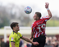 Lincoln City's Danny Rowe vies for possession with Cheltenham Town's Charlie Raglan<br /> <br /> Photographer Chris Vaughan/CameraSport<br /> <br /> The EFL Sky Bet League Two - Lincoln City v Cheltenham Town - Saturday 13th April 2019 - Sincil Bank - Lincoln<br /> <br /> World Copyright &copy; 2019 CameraSport. All rights reserved. 43 Linden Ave. Countesthorpe. Leicester. England. LE8 5PG - Tel: +44 (0) 116 277 4147 - admin@camerasport.com - www.camerasport.com
