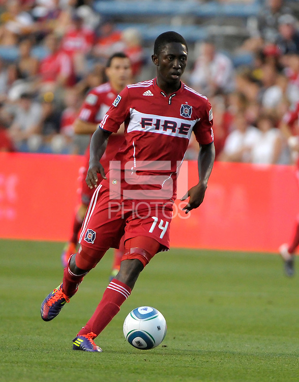 Chicago forward Patrick Nyarko (14) dribbles the ball.  The Portland Timbers defeated the Chicago Fire 1-0 at Toyota Park in Bridgeview, IL on July 16, 2011.