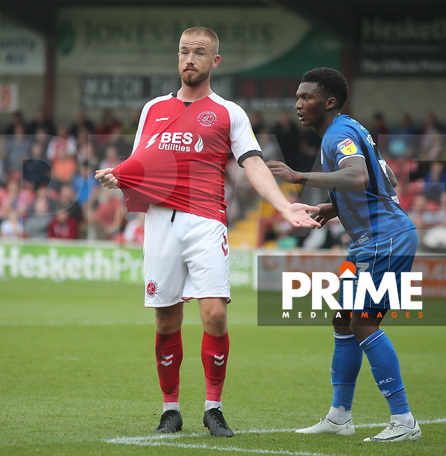 Patrick Madden of Fleetwood Town appears to the match referee for a shirt pull during the Sky Bet League 1 match between Fleetwood Town and Rochdale at Highbury Stadium, Fleetwood, England on 18 August 2018. Photo by Stephen Gaunt / PRiME Media Images.