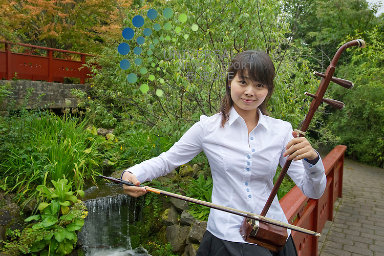 Peking University Orchestra play traditional Chinese instruments in the China themed garden at the Royal Botanic Garden's in Edinburgh ahead of a concert at the University of Edinburgh, Scotland, 10th September, 2012..Picture:Scott Taylor Universal News And Sport (Europe) .All pictures must be credited to www.universalnewsandsport.com. (Office)0844 884 51 22.