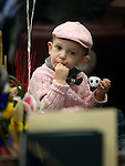 Sawyer Silberkraus, 22 months, plays on his dad's desk on the Assembly floor at the Legislative Building in Carson City, Nev., on Friday, April 3, 2015. <br /> Photo by Cathleen Allison