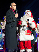 """United States President Barack Obama on stage with Santa Claus to sing """"Jingle Bells"""" as he and the First Family attend the National Christmas Tree Lighting on the Ellipse in Washington, DC on Thursday, December 1, 2016.<br /> Credit: Ron Sachs / Pool via CNP"""