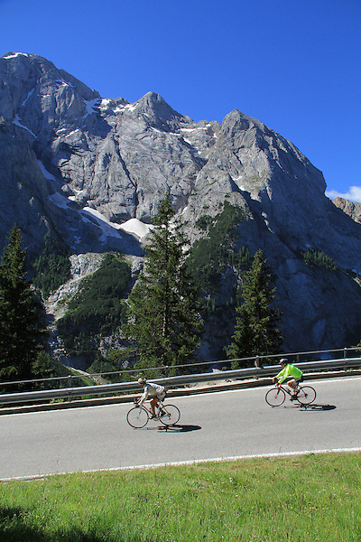 Cyclists with Mt Marmolada behind, Dolomites, northern Italy, Europe. .  John offers private photo tours in Denver, Boulder and throughout Colorado, USA.  Year-round. .  John offers private photo tours in Denver, Boulder and throughout Colorado. Year-round.