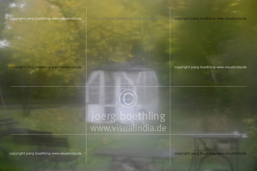 GERMANY, baltic sea, island Ruegen, look at garden pavillon, out of focus, seen through damp window