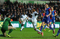 Swansea city's Jonathan de Guzman looks to chip Palace keeper  Julian Speroni. Barclays Premier league, Swansea city v Crystal Palace match at the Liberty Stadium in Swansea, South Wales on Sunday 2nd March 2014.