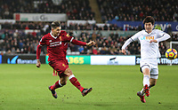 Roberto Firmino of Liverpool hits a shot past Ki Sung-Yueng of Swansea City during the Premier League match between Swansea City and Liverpool at the Liberty Stadium, Swansea, Wales on 22 January 2018. Photo by Mark Hawkins / PRiME Media Images.