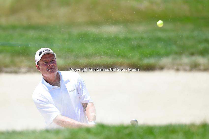 June 22, 2014 - Cromwell, Connecticut - Brice Garnett hits his way out of a bunker on the 11th hole during the final round of the PGA Travelers Championship tournament held at TPC River Highlands in Cromwell, Connecticut.  Eric Canha/CSM