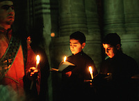 Alter boys hold cndles as they serve mass at the Armenian Orthodox Chruch of the Sepulchre. Jerusalem, Israel.