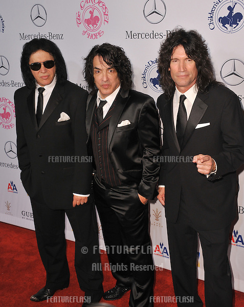 KISS stars Gene Simmons (left), Paul Stanley & Tommy Thayer at the 26th Carousel of Hope Gala at the Beverly Hilton Hotel..October 20, 2012  Beverly Hills, CA.Picture: Paul Smith / Featureflash