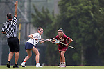 CHAPEL HILL, NC - MAY 12: Elon's Stephanie Asher (1) and Virginia's Avery Shoemaker (center) wait for a signal from match official Brett Bjork (left) before contesting a draw. The Elon University Phoenix played the University of Virginia Cavaliers on May 12, 2017, at Fetzer Field in Chapel Hill, NC in an NCAA Women's Lacrosse Tournament First Round match. Virginia won the game 11-9.