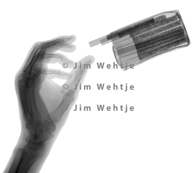 X-ray image of reaching for cigarettes (black on white) by Jim Wehtje, specialist in x-ray art and design images.