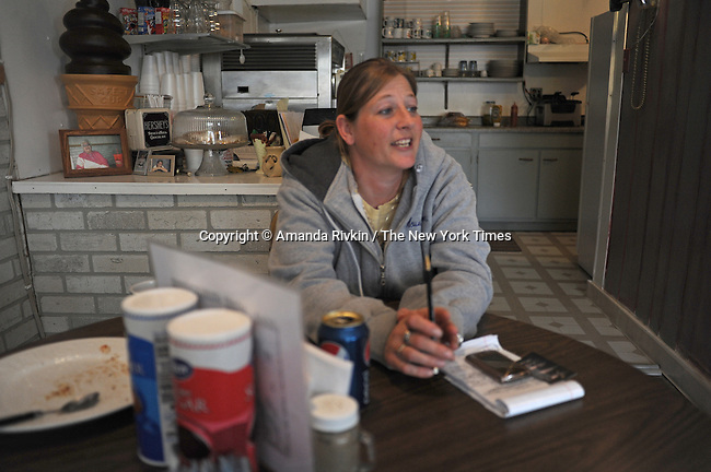 Jeni McCubbins, 38, at E.J.'s Memories Ice Cream on the main drag, Elm Street, of tiny Eldon, Iowa on April 23, 2009. Eldon, located about one and a half hour southwest of Iowa City, has a population of 1,200 and is the hometown of the American Gothic house.