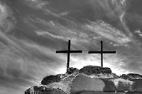 Two crosses on rock with clouds in Arizona - BW