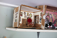 """Prototypes of her now famous """"Home Tweet Home"""" birdhouses stand on a shelf in Jada Fitch's living room, which doubles as her art studio, in Portland, Maine, USA, on Fri., July 28, 2017. Fitch has recently been making birdhouses that look like living rooms with small portraits of birds. The birdhouses sell out within minutes on her Etsy store. The first birdhouse she made is on the left of the shelf, followed by numbers two and three."""