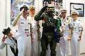 "Master Chief (Halo) poses with Japanese marines at  the Niconico Douga fan event at Makuhari Messe International Exhibition Hall on April 25, 2015, Chiba, Japan. The event includes special attractions such as J-pop concerts, Sumo and Pro Wrestling matches, cosplay and manga and various robot performances and is broadcast live on via the video-sharing site. Niconico Douga (in English ""Smiley, Smiley Video"") is one of Japan's biggest video community sites where users can upload, view, share videos and write comments directly in real time, creating a sense of a shared watching. According to the organizers more than 200,000 viewers for two days will see the event by internet. The popular event is held in all 11 halls of the huge Makuhari Messe exhibition center from April 25 to 26. (Photo by Rodrigo Reyes Marin/AFLO)"