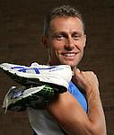 Modena, Stefano Baldini campione olimpionico maratona con le sue scarpe da corsa Olympic marathon champion Stefano Baldini with his running shoes