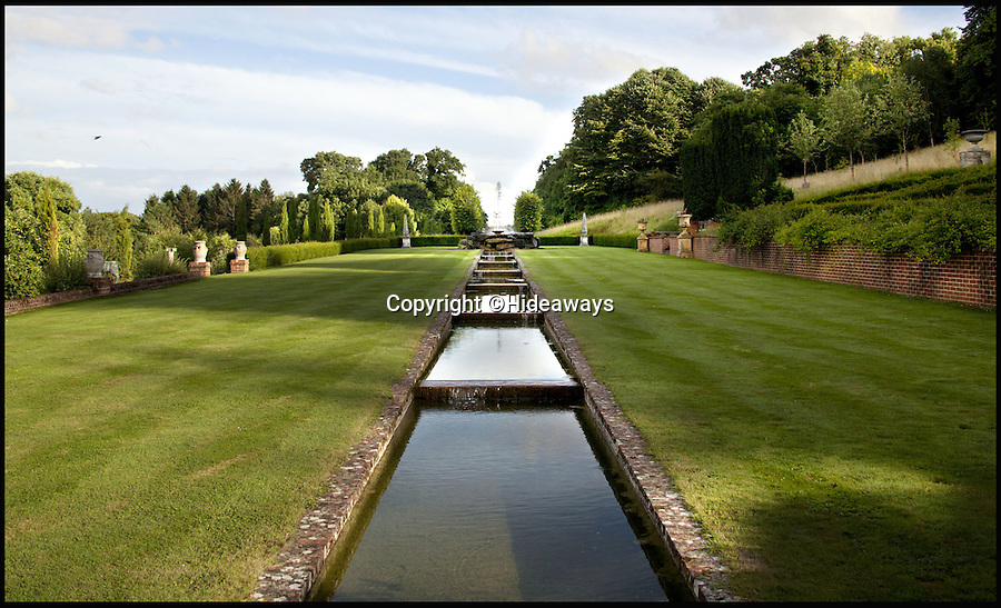 BNPS.co.uk (01202 558833)<br /> Pic: Hideaways/BNPS<br /> <br /> Stunning gardens leading up to an 65ft Mughal Arch.<br /> <br /> You can now live like a king... but it will cost you £6,000 a week!<br /> <br /> This stunning historic house offers the ultimate 'Lord of the Manor' experience - but you'll need deep pockets to enjoy the life of luxury.<br /> <br /> The Grade II* listed King John's House has eight opulent bedrooms and exquisite period features dating back to medieval times, but staying there will set you back a whopping £5,682 per week.<br /> <br /> The site in Tollard Royal, Wiltshire, was once a Royal hunting lodge used by King John in the early 13th century but since the death of the last owner William Gronow Davis last year it has now become a very exclusive rental property for groups wanting to celebrate a milestone birthday or anniversary in style.