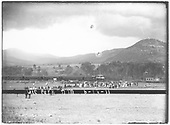 Distant view looking south acros Ute Park valley of baseball diamond with a holiday crowd and passenger train behind.  Freight caboose is on track at right.  Location and date are on image.<br /> St. Louis, Rocky Mountain &amp; Pacific Ry.  Ute Park, NM  Taken by Troutman, Edward A. - 6/18/1911