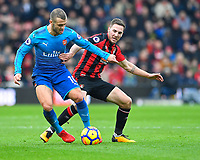 Jack Wilshere of Arsenal left shields the ball from Dan Gosling of AFC Bournemouth during AFC Bournemouth vs Arsenal, Premier League Football at the Vitality Stadium on 14th January 2018